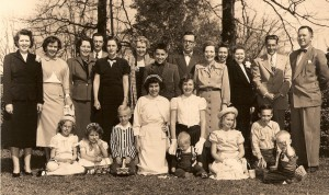 "McDaniel family at ""Far Enough""  Picture dated  1950 or 1951 Standing     L to R   Laura Young, Toni Snider, Sara Snider, Howard Snider, Francis 	Schmidt, Marion McDaniel, CB McDaniel Jr., CB McDaniel, Willie Ruth Banks, Sue Spencer, 	Mary Fowler, Robert Spencer, Robert  McDaniel. 	Sitting      L to R   Susanne Schmidt, Charlotte Snider, Howard Snider Jr, Martha Snider, Laura 	Spencer, Tom Spencer, Susanne Spencer, Peter Schmidt, John Spencer."