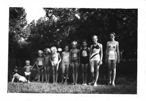 Kids going swimming in the creek by Lizzie Bees. This picture was taken in the 1940s and includes children of Sara Snider, Sue Spencer, and others.