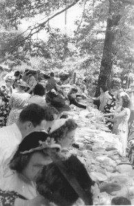 The men of the church had built long tables in rows under the trees. Alabama is hot and the last weekend of May was a prelude to the summer to come. After plates were filled many went to the cemetery to sit under the trees and on the brick wall that marked the cemetery dimension.
